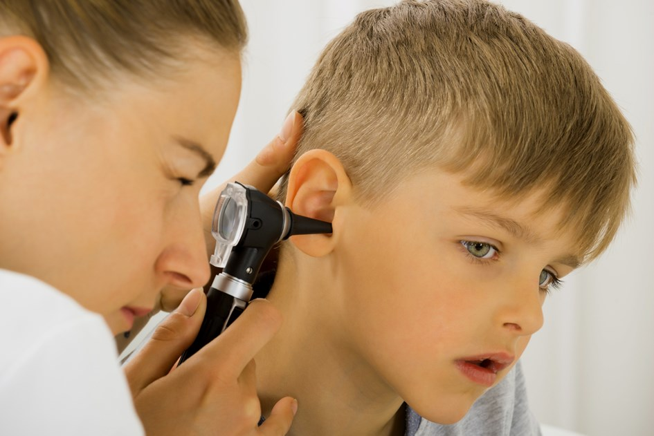 16493692-doctor-examining-boy-s-ear2.jpg