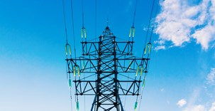 power-transmission-pylon-against-blue-sky.jpg