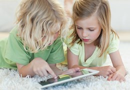 3618887-siblings-on-the-floor-using-tablet.jpg